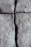 Volcanic stone with cracks forming a cross Royalty Free Stock Photography