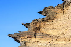 Volcanic stone formation with blue sky at el Golfo Stock Photo