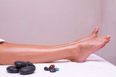 Volcanic stone massage Stock Image