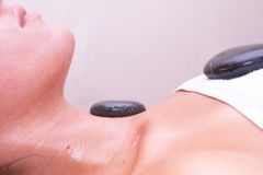 Volcanic stone massage Stock Photography