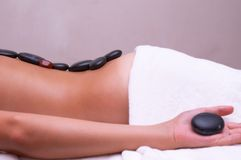 Volcanic stone massage Royalty Free Stock Image