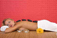 Volcanic stone massage Stock Photo