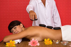 Volcanic stone massage at the spa Stock Image