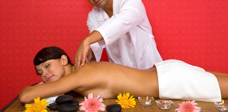 Volcanic stone massage at the spa Stock Photo