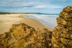 Volcanic stones on the beach in Australia stock photos