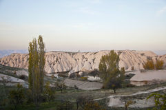 Volcanic Tuff of Cappadocia. The sediments of volcanic tuff in Cappadocia near the Uchisar Castle in the evvening Stock Photography