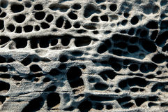 Volcanic tuff rock. Surface background Royalty Free Stock Images