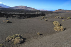 Black volcanic sand at Timanfaya National Park, Lanzarote Island royalty free stock photo