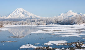 Volcano. Beautiful winter landscape with volcano and lake Royalty Free Stock Photos
