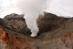 Volcano. A smoking crater of Bromo volcano Stock Image