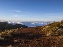 Volcano (above the clouds) Stock Photography