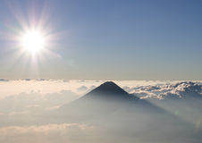 Volcano Agua in clouds. Sunset in Guatemala, View from Volcano Acatenango to volcano Agua Royalty Free Stock Photography