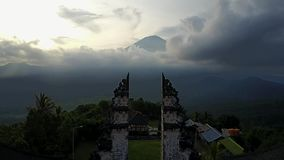 Volcano Agung at sunset. Gate of the Temple of Lempuyang. Shooting from the air. Beautiful clouds. stock video footage