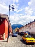 Volcano in Antigua, Guatemala. Antigua, Guatemala, clouds, colonial architecture, colorful buildings Stock Photos
