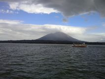 Volcano and boat in Ometepe Island, Nicaragua Royalty Free Stock Photos