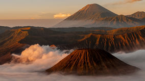 Volcano Bromo with fog and mist at sunrise Stock Photos