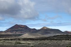 Volcano caldera crater. Volcanic landscape. In Lanzarore, Canary Islands, Spain royalty free stock image