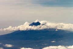 Volcano with  clouds Royalty Free Stock Photo