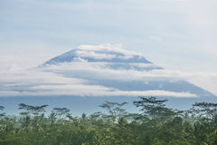 Volcano in the clouds, Indonesia Royalty Free Stock Image