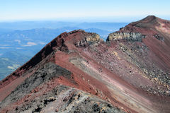 Volcano crater after erruption. Volcano gray lava rocks and ash. Volcanic rocks. Gray and red frozen lava stones after volcano erruption Stock Photos