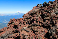 Volcano crater red frozen lava rocks. Volcanic stones Royalty Free Stock Image