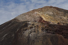 Volcano crater rim with person on top. A view up and along the crater rim of the volcano Cerro Negro with a person standing at the far off tip stock photos