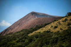 Volcano in the sun Royalty Free Stock Image