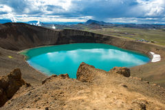 Volcano crater Viti with turquoise lake inside, Krafla volcanic area, Iceland. Volcano crater Viti with turquoise lake inside, sand and snow, Krafla volcanic Stock Photo