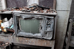 Volcano Damaged Melted Television. A television in a house in Central Java hit by a pyroclastic flow, the most feared volcanic eruption in which a super hot gas royalty free stock photography
