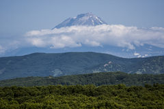 Volcano dreams. Avachinsky volcano in the clouds, Kamchatka Royalty Free Stock Image