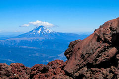 Volcano after erruption. Volcano gray lava rocks and ash. Volcanic rocks. Gray and red frozen lava stones after volcano erruption stock photo