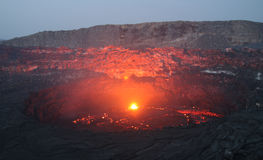Volcano Erta Ale before sunrise. Viewfrom the south crater rim into the active Erta Ale south crater with its lava lake. This picture shows the seldom situation Stock Photo