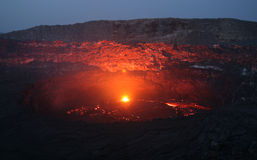 Volcano Erta Ale before sunrise. Viewfrom the south crater rim into the active Erta Ale south crater with its lava lake. This picture shows the seldom situation Royalty Free Stock Photography