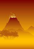 Volcano erupting. The volcano erupts above the tropical jungle Stock Photo
