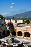 Volcano Eruption. A volcano spits ash into the air over the largest foutain in Central America, at the historic convent La Merced in Antigua, Guatemala Stock Photography