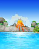 Volcano eruption by the lake Stock Photo