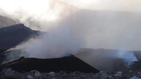 Volcano Etna eruption - explosion and lava flow in Sicily stock video footage