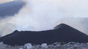 Volcano Etna eruption - explosion and lava flow stock video footage