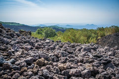 Volcano Etna view with lava stones. And mist ant horizon, Sicily, Italy Royalty Free Stock Image