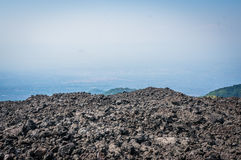 Volcano Etna view with lava stones. And mist ant horizon, Sicily, Italy Royalty Free Stock Images