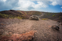 Volcano Etna view Silvestri crater with big stone in front. Sicily, Italy royalty free stock image