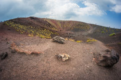 Volcano Etna view Silvestri crater with big stone in front. Sicily, Italy royalty free stock photos