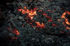 Volcano, fire, crust. Danger, hazard, energy concept. Magma textured molten rock surface. Volcano, fire, crust. Lava flame on black ash background. Formation stock image