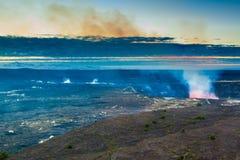 Volcano glow. Glow of an erupting volcano at early sunrise at Hawaii Volcanoes National Park, Big Island, Hawaii Royalty Free Stock Photos