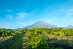 Volcano Gunung Agung with clear blue sky from Amed in Bali, Indo. The volcano Gunung Agung dominating the horizon taken from Amed against a clear blue sky, a Royalty Free Stock Photography