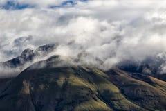 Volcano Imbabura engulfed in clouds in Ecuador. The peak of volcano Imbabura engulfed in clouds in ibarra Ecuador Royalty Free Stock Photo