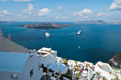 Volcano island with cruisers anchored around at Santorini. Greece Royalty Free Stock Images