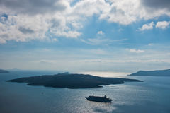Volcano island with cruisers anchored around at Santorini. Greece Royalty Free Stock Photography