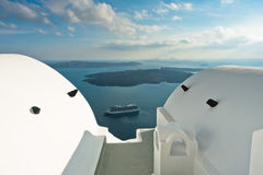 Volcano island with cruisers anchored around at Santorini. Greece Royalty Free Stock Photos
