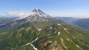 Volcano in Kamchatka. The span of the camera to the volcano stock footage